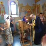 Священник готовится к таинству крещения. Мегрелия